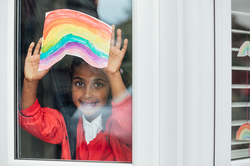 Girl holding a rainbow poster